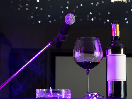 Microphone and a glass of wine in music room