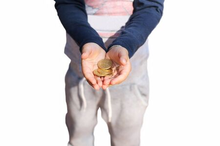 Childs Hand Holding Pretend Coins in white background