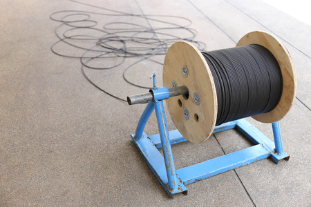 internet  broadband: Power cable drum with optical fiber cable for telecomunication and internet broadband connection