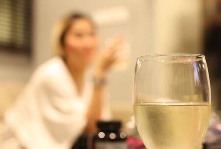 White wine glass with lipstick print on glass