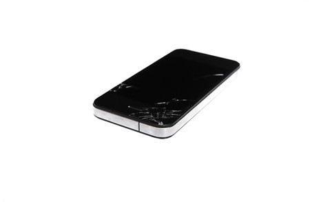 black mobile phone with a broken screen on an isolated background photo
