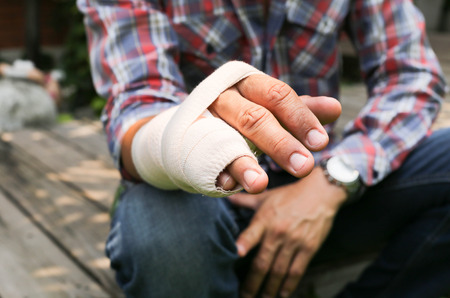 accident patient: Splint broken bone  hand Injured in blur background Stock Photo