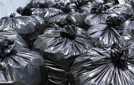 Pile of Black garbage bag on the street 스톡 콘텐츠