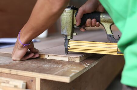 woodwork: Carpenter used a nail gun on woodwork