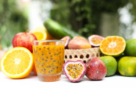 half stuff: Selected Focus glass of fresh passionfruits and vegetables in blur background