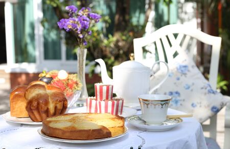 Apple tart with bread and fruit at tea time in the garden photo