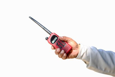 cb: Security guard hand holding red cb walkie-talkie radio reaching out