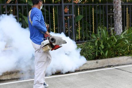 Unidentified man fogging mosquito to prevent of dengue fever