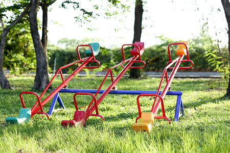 totter: Seesaw board at public playground park on sunny day Stock Photo