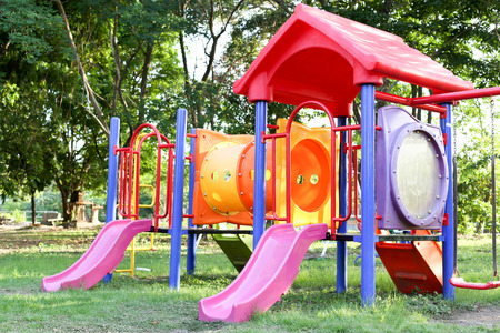 children play: Colorful children play ground in park in summer time