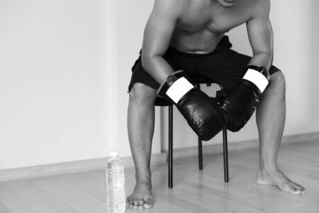 sit down: Man sit down resting on doing boxing excercise with bottole of water