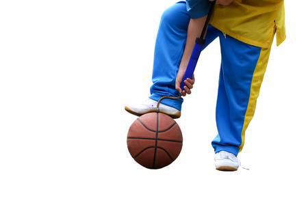 compressed air hose: School boe hand pumping up basketball over white background