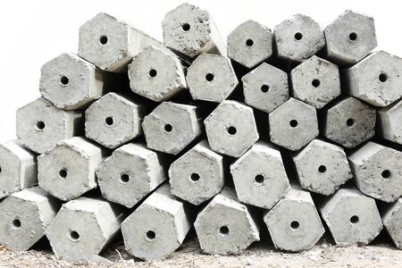 cornerstone: The pile of hexagon concrete foundation piles isolated in white background