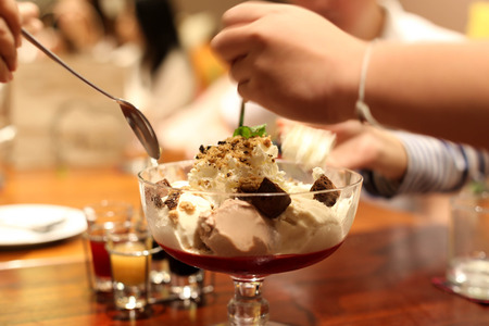 dessert: Family enjoying day out having an iced cream in a restaurant