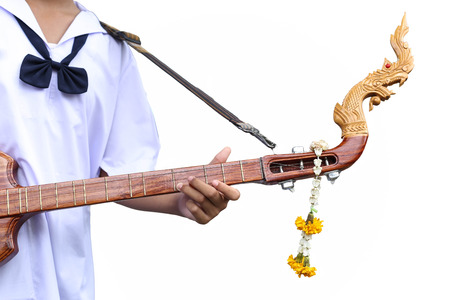 stringed: Studen artist playing Phin stringed plucked instrument Thai culture Stock Photo