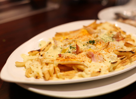 strips away: French fries and parmesan cheese  with ground paprika and bacon
