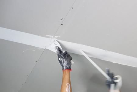 左官こて天井に石膏を広める 写真素材