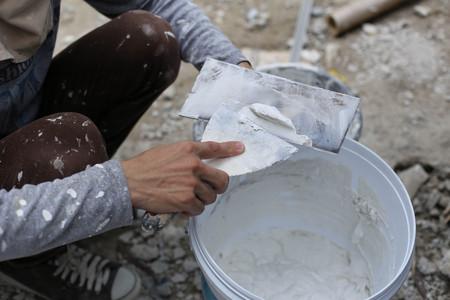 Plasterer mixing a plaster in bucket for renovation decoration Standard-Bild