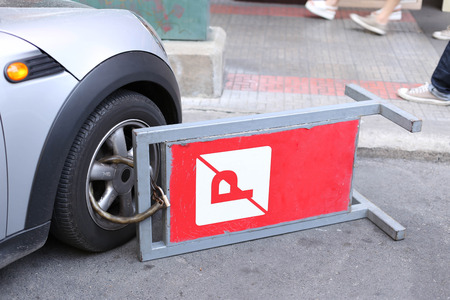 clamped front wheel of illegally parked car on thr road