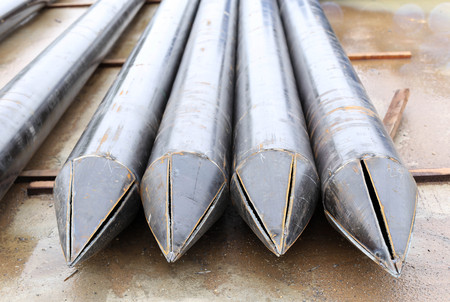 ferrous foundry: The big metal pipes pointe in workshop Stock Photo