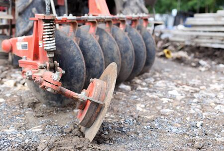 earthing: Tractor with metal blade at the construction site