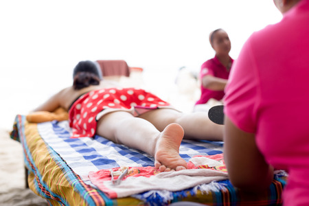 chiropodist: Woman having foot scrub on the beach Stock Photo