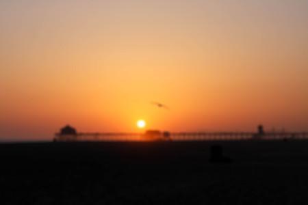 huntington beach: Blurred background sunrise and sunset Huntington Beach, California over the bridge Stock Photo