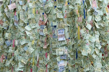 compile: Thai banknotes background as offering money tradition for religion