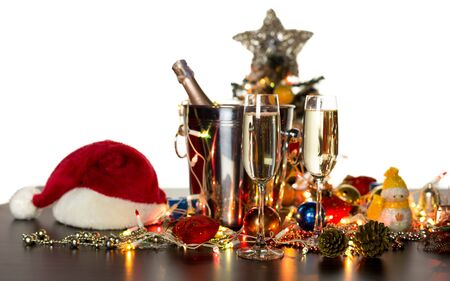 eve: Glass of Champagne and Christmas decorated isolated on white background