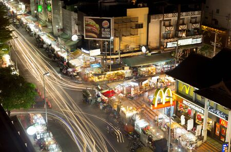 let s: CHIANG MAI THAILAND - 8 Dec 2015 : Logo McDONALDS , BURGERKING and Let s Relax at Night Bazaar market with traffice light trail Editorial