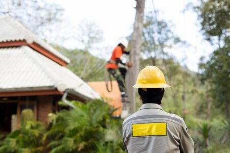 lineman: Electrician lineman working on electric post power pole