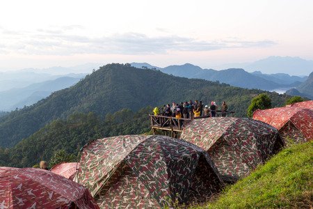 camping site: Dec  9   15 : Unidentified group of people watching sunrise and Camping site at Doi Ang Khang Chiang Mai Thailand