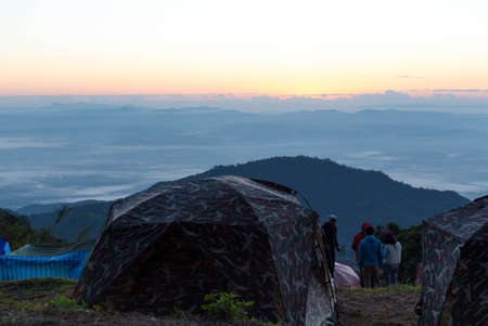 camping site: Unidentified group of people Watching sunrise and Camping site in Doi Ang Khang Chiang Mai Thailand Stock Photo