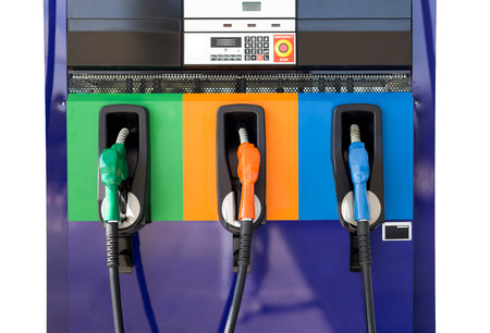 unleaded: Front oview of Petrol pump filling at gas stationg