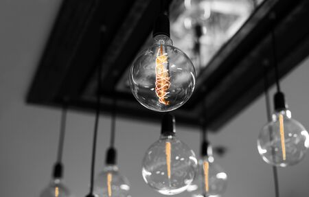 Set of antique light bulbs decor glowing light on the ceiling Stock Photo