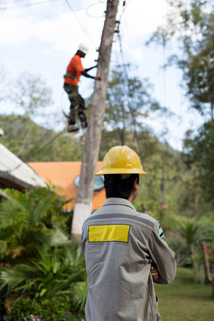 lineman: Electrician lineman working on electric postt power pole
