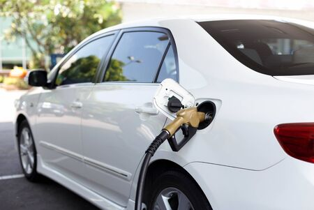 refueling: Car refueling with petrol pump from petrol station. Stock Photo