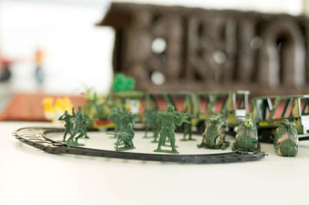 green military miniature: Image group of green miniatur toy soldiers with guns and  helicopter
