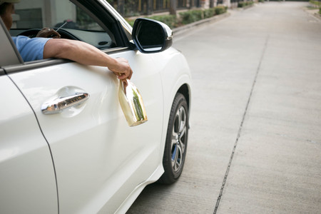 slurp: Drinking alcohol while driving car is dangerous