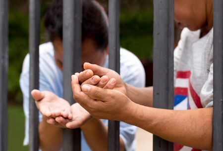 reach out: Concept immigrant crisis Refugee peoples hand reach out praying for hope