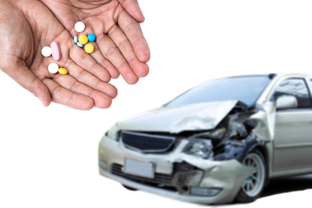 Take pills while  driving is dangerous on the road Standard-Bild