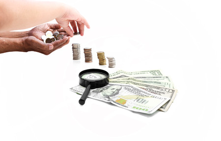 business help: Saving concept hand holding coins with dolla  bank note in white background Stock Photo