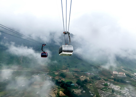 Cable Car way with rice terrace on the moutain in foggy day