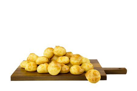 puff: French Cake eclairs on wooden board isolated on white background Stock Photo