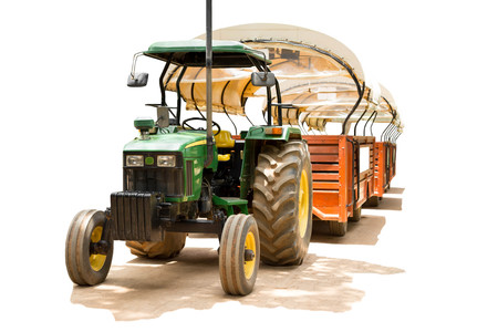 Farmer tractor with canvas roof for a tourist isolated in white background