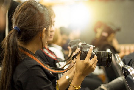 Education concept woman hand holding camera in workshop room 스톡 콘텐츠