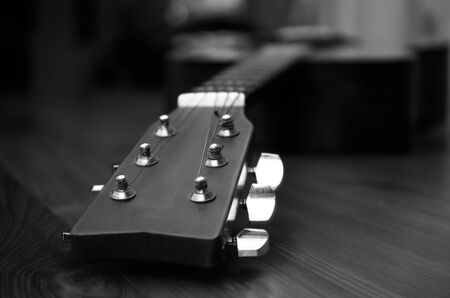 pegheads: High contrast Acoustic guitar head in black and white background Stock Photo