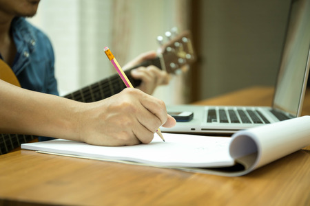 Selected focus on pencil songwriter working on new composition with laptop on the table Standard-Bild