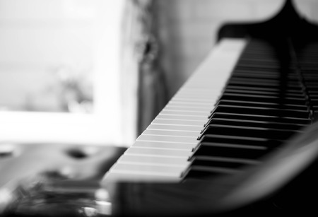 musical score: Selected focus piano keys in black and white