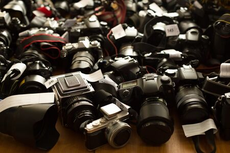 Different make of cameras on the table Stock Photo